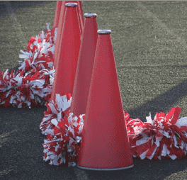 Red cheer megaphones with red and white pom poms